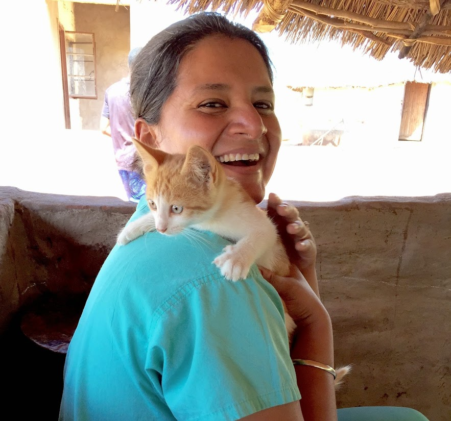 With a furry friend at the home of an HIV-affected family