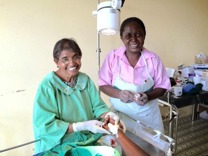 Dr. Neela and nurse dressing a wound
